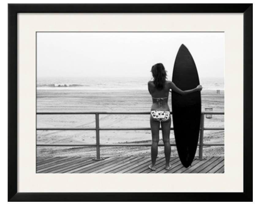 Model with Black Surfboard Standing on Boardwalk and Watching Wave on Beach By Theodore Beowulf Sheehan. Image via Art.com.