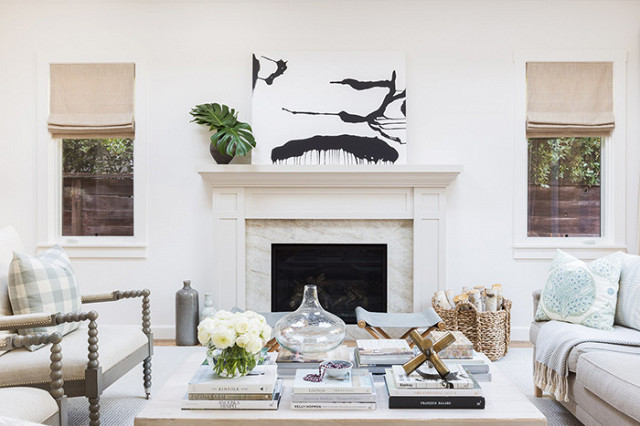 We just love a fireplace as a focal point.  Especially a light, neutral fireplace that serves to both create drama and spread a feeling of calmness at the same time. The designer on this project, Amanda Barnes ,  carried this relaxed, zen-like vibe throughout the home by mixing quiet, coastal colors with rich textures and subtle pops of color and pattern.  Worth a peek if you're looking to add relaxing elements to your home.   Source:  MyDomaine