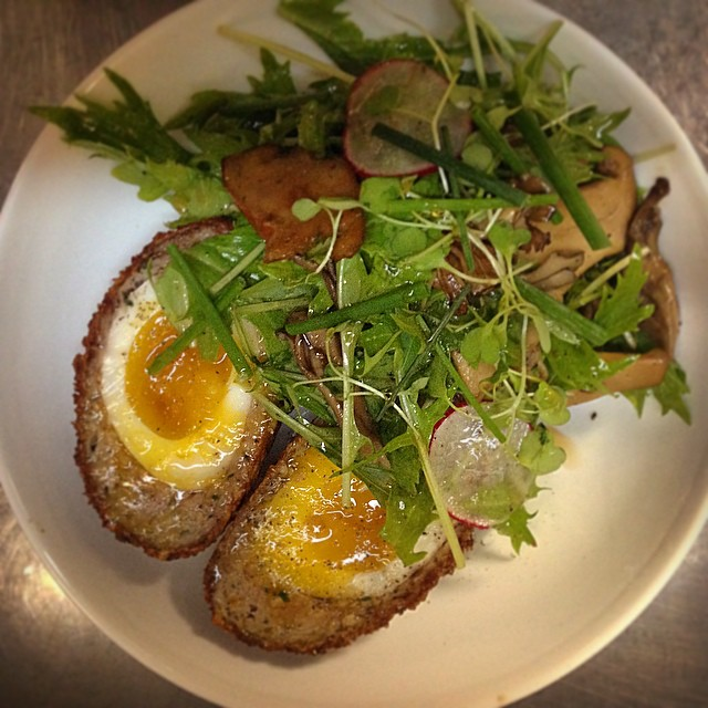 Scotch Egg and Wild Mushrooms - soft boiled egg encased in pork sausage, breaded and served with wild mushrooms and tossed with mizuna and a sherry vinaigrette. #smalleats #thebrooklynstar #scotchegg #nitamago #egg #wildmushroom #mizuna