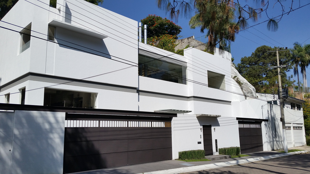 Imposing facade common to a majority of the homes in this affluent neighborhood -