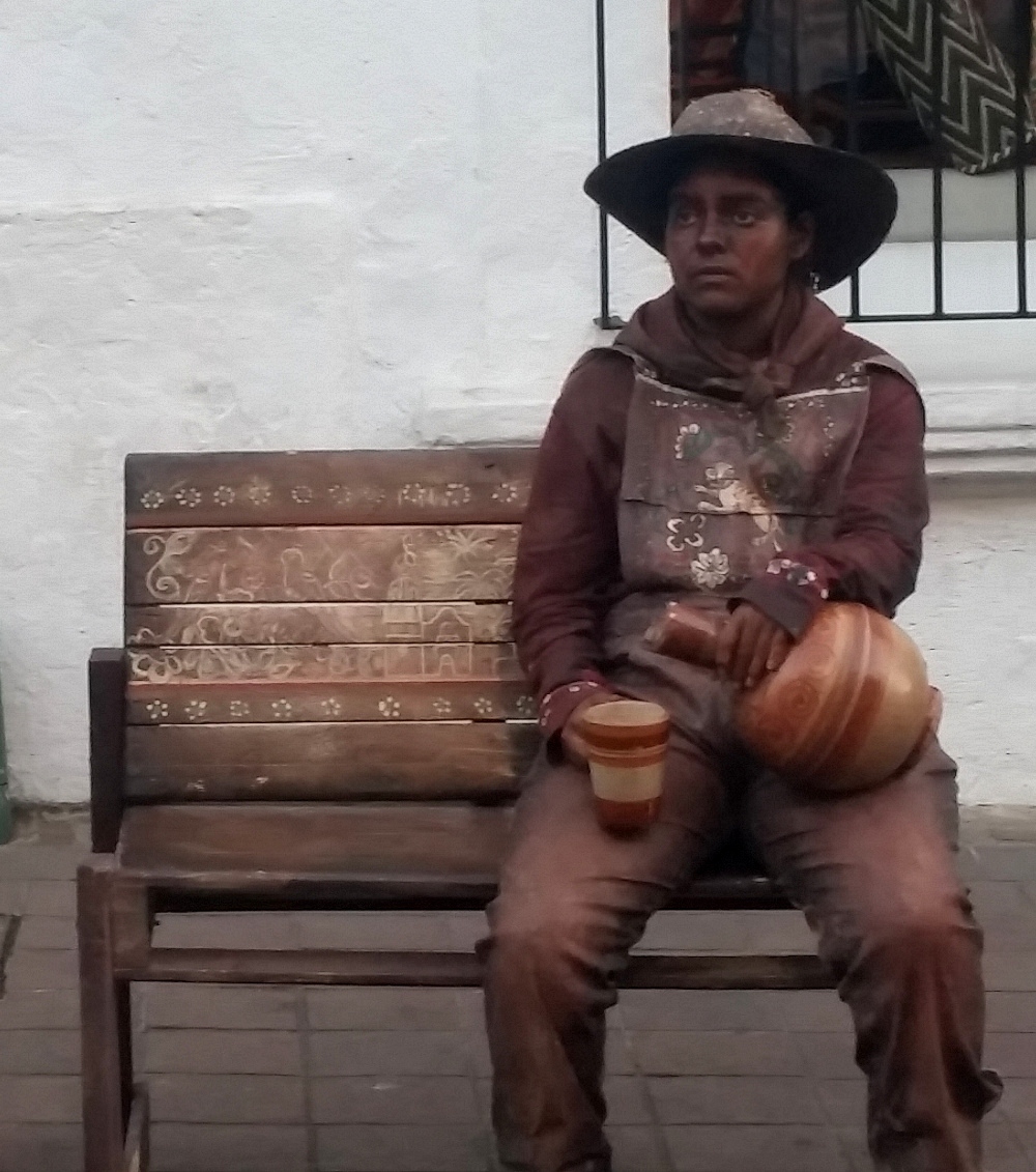 Fascinating performance art - the haunted look of a Mexican peasant. -