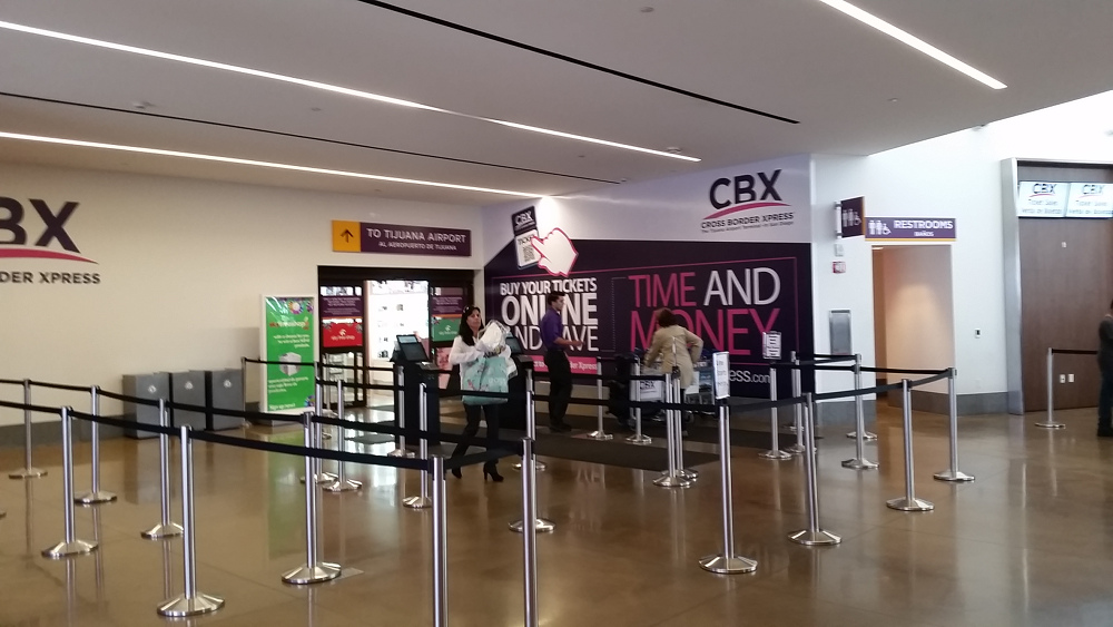 - This is the entrance to the pedestrian walkway from the San Diego side of the Tijuana airport (It goes right through the duty-free store first).