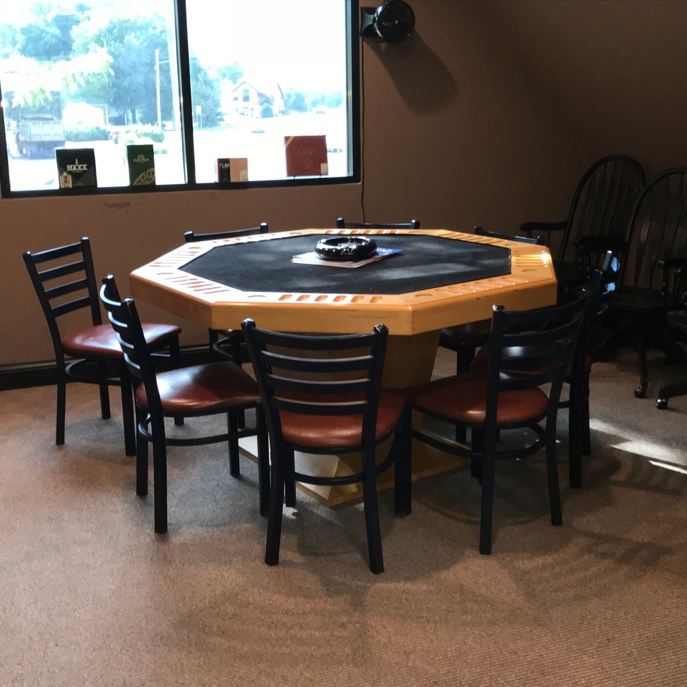Our game room is ready for cards, darts and other games, and there's even a comfy leather couch & chairs where you can talk with friends and watch TV