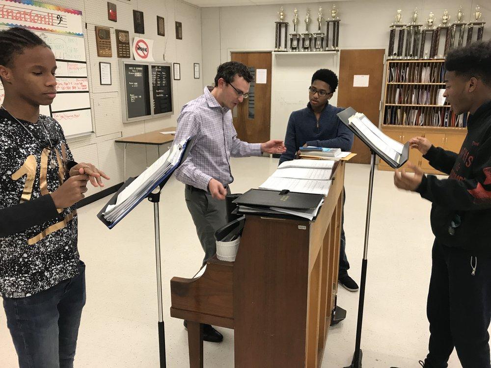 Music Director Matthew Hayner works with the ensemble trio.