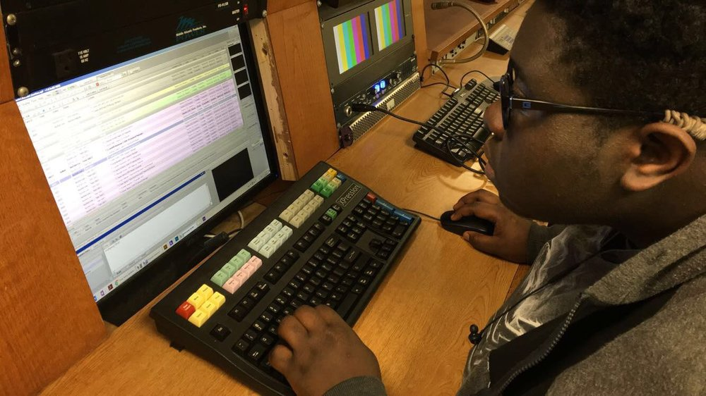 Junior Tanshie Achoh makes the final lower thirds for GHS-TV's live  Auction
