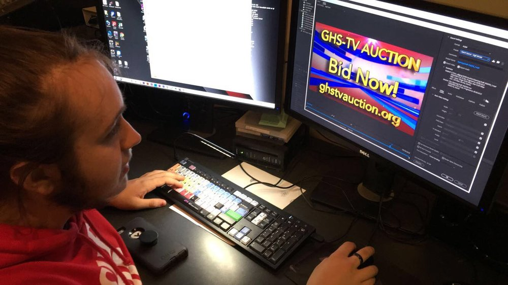 Senior Wolfgang Stoltz puts the finishing touches on GHS-TV'S  Auction graphic.