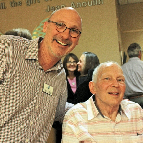 Hospice of Santa Barbara CEO David Selberg (left) and local artist Jim Hill at the opening of Hill's solo art exhibition
