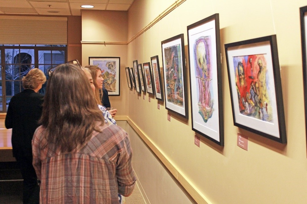 Guests enjoy the work of artist Jim Hill