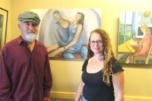 "Maya Chafe, with guest and sculptor Robert Ervin and ""Untitled (Lovers, Playing),"" an original piece by her father, longtime Santa Barbara artist Gary Chafe. The works are on display at Hospice of Santa Barbara through June 29. (Rochelle Rose / Noozhawk photo)"
