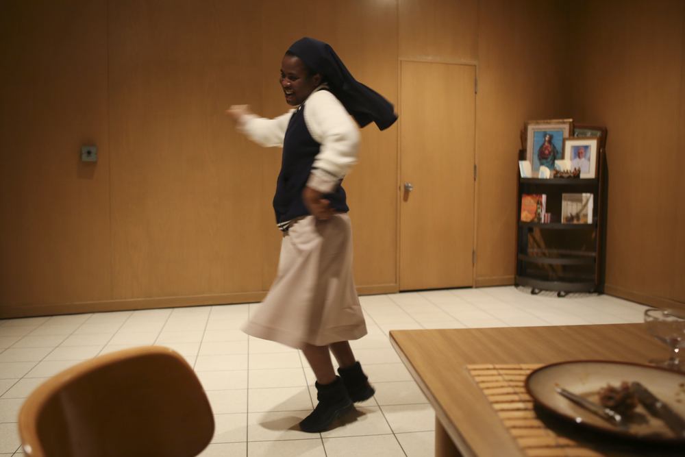 Sister Evelyn does a Bollywood dance after dinner at the convent house in Yonkers.