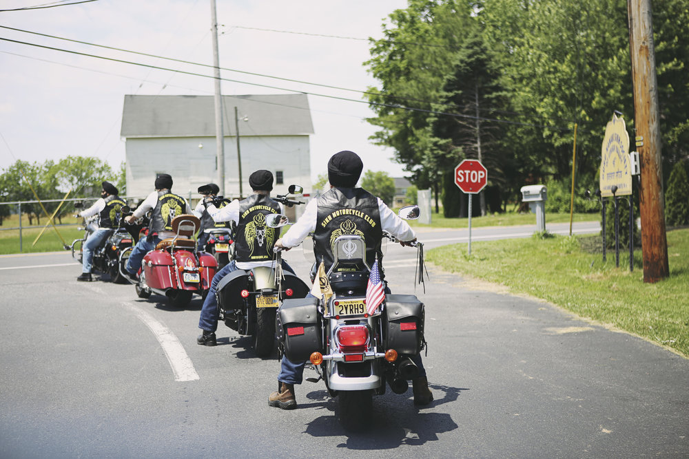Riders form a line on the road leading out of a gurudwara in Nazareth, PA.