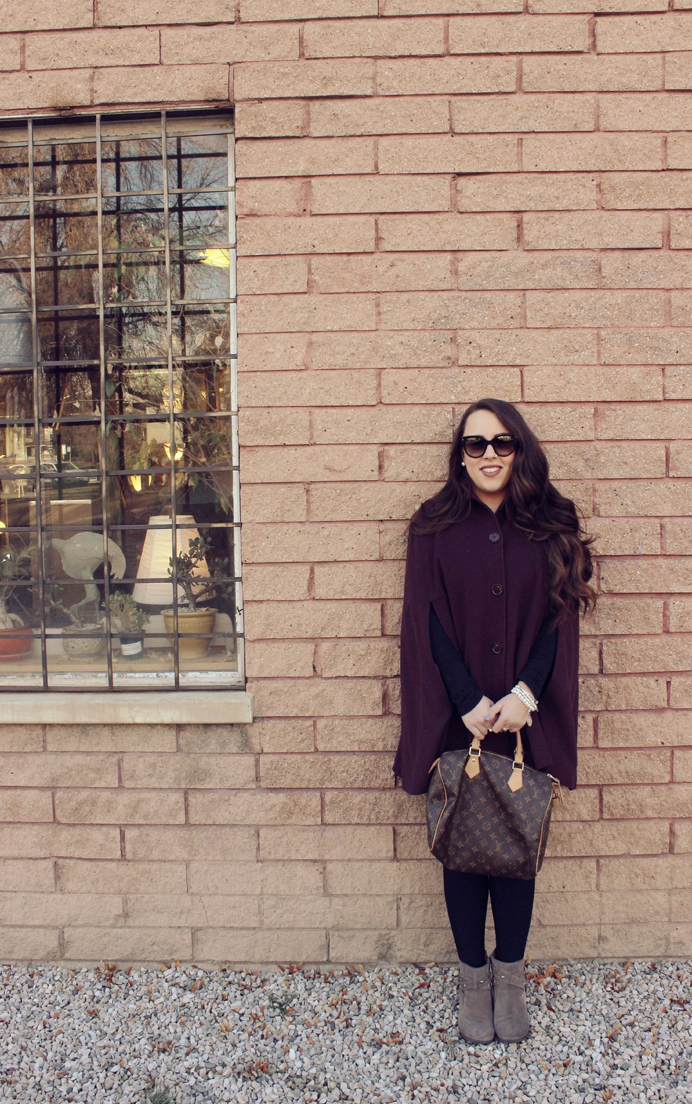 Cape: Helene Berman- Sold Out. Similar Here. Sunnies: Prada. Booties: Sole Society- Sold out. Similar Here.  Bag: Louis Vuitton.