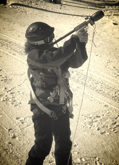 Shooting a messenger line over a haul cable during lift evacuation training at Eldora Mountain Resort, Nederland, CO.