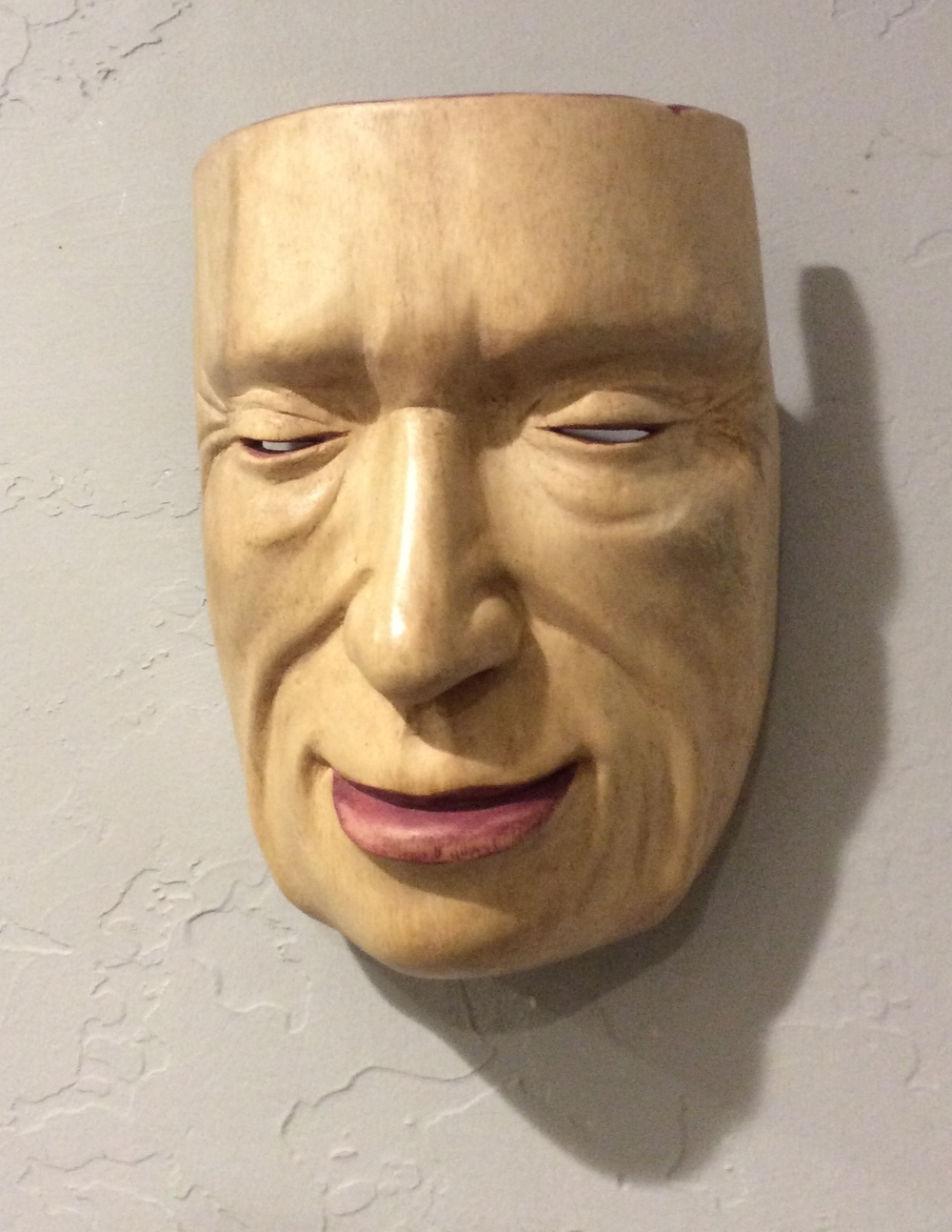 The mask that I carved for the first workshop has a maroon acrylic wash on the back that comes through to the front for the lips, nostrils and eye lids. I worked really hard on trying to maintain the symmetry of this mask as I worked on it.