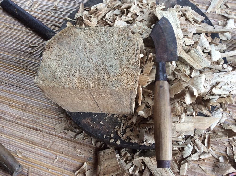 I was introduced to a couple of brand new tools.  In the past carving at the weekend workshops Anom has brought us roughed out blanks.  Now I got to use the layout tool, a large Balinese hatchet and an ax to try to get the piece of wood to that same roughed out state.  So I spent about 8+ hours learning, or trying to learn to use these new tools.  It was very humbling to say the least.  It has also renewed my empathy level for new woodcarvers as well.