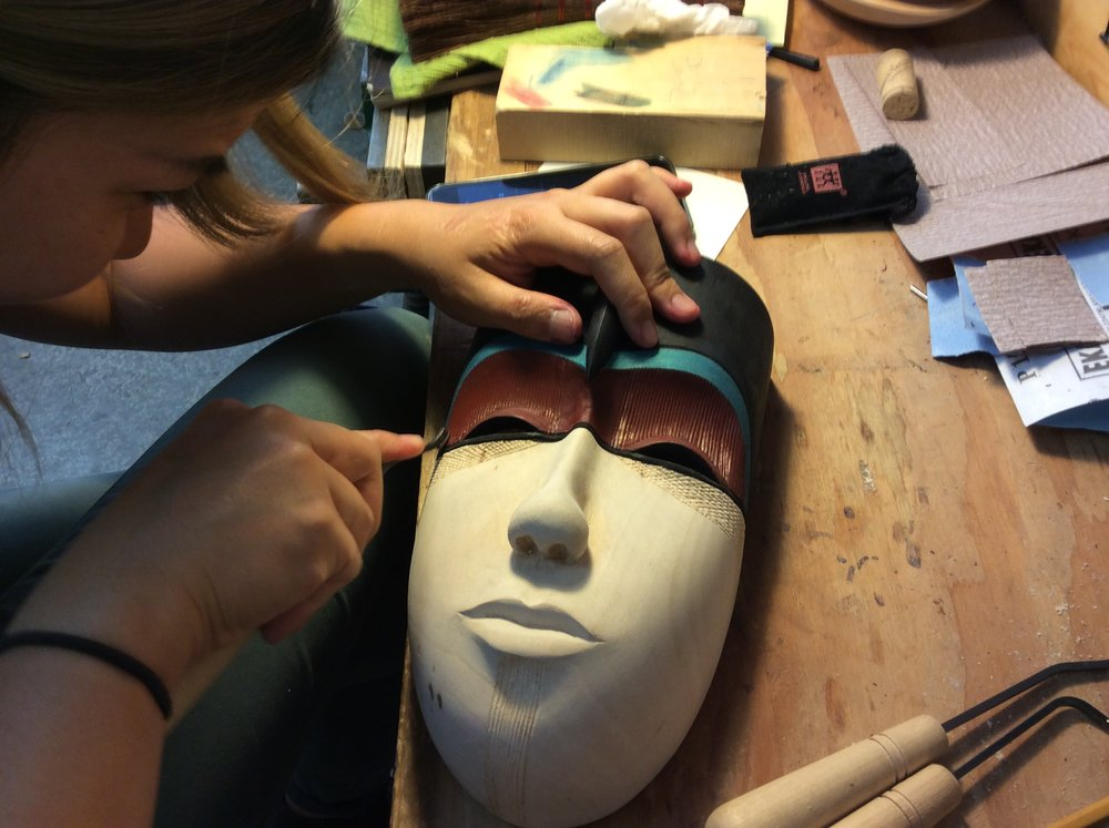 Twiggy joined us from the Randall Museum class.  She carved her Grapes and Leaves and then carved this beautiful mask.  it was her very first Mask and she did a wonderful job of adding texture (gun checkering tools) and color.