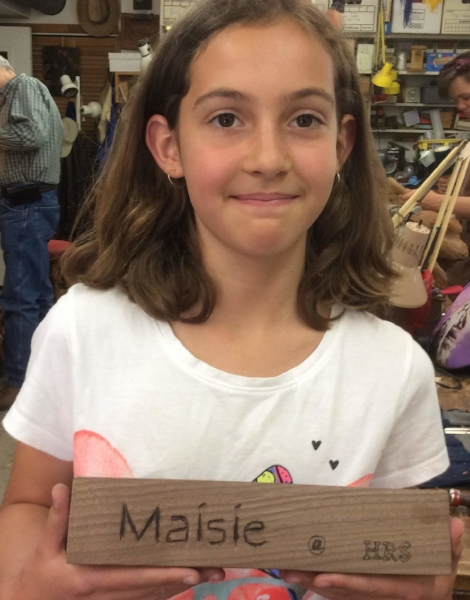 Maisie carved and wood burned this walnut name plaque for her desk.