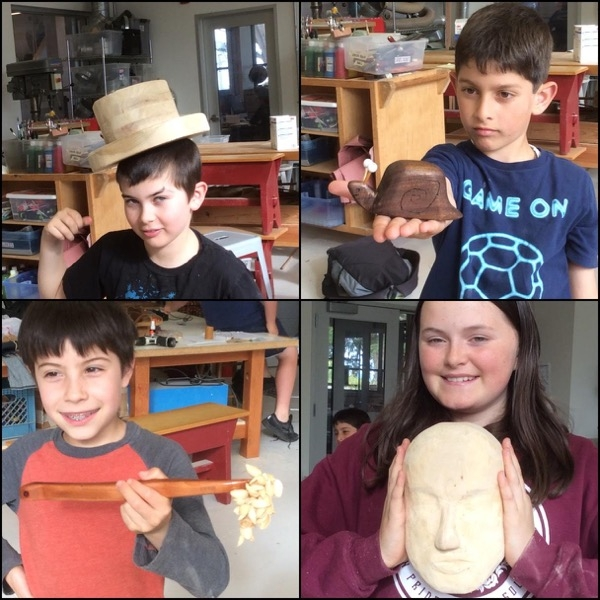 The Randall Kids carving class with a wooden hat, carved snail, rattlesnake and Mask with no hair.