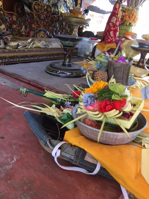 Freshly sharpened tools topped with beautiful floral arrangements and incense.