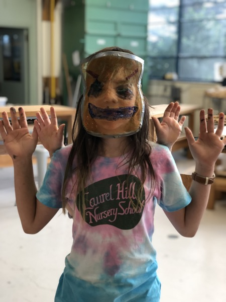 Sophia models her Halloween masks from the Randal Kids Carving Class made on Oct 31.