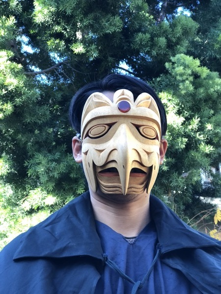 Here is Twiggy's mask from the Balinese mask carving class painted and with a stone inlaid in the front. Her husband Arthur is modeling it. Pretty dramatic.