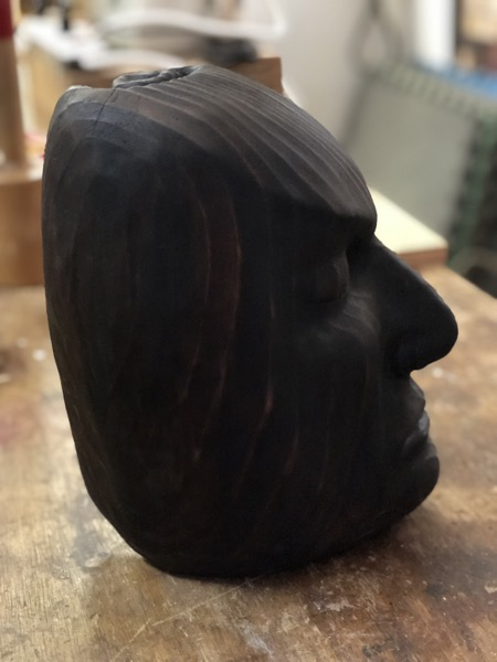 For many years I have had a desire to carve the wonderfully dramatic profile of an artist that I met many years ago.  He was a  puppeteer, dancer and all around fabulous artist.  This angled chunk of wood called out to me.