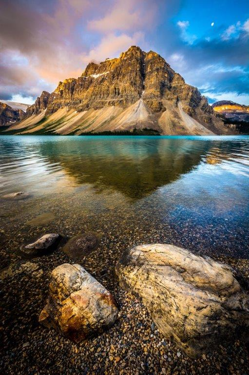 Crowfoot Mountain at Bow Lake in the Rockies at dawn.  Available in both canvas and fine art paper prints.