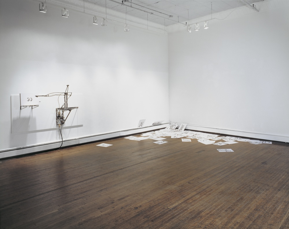 Placard Flinger, 1995, Steel, pneumatics, rubber, motor, and ink on cardboard, 48 x 60 x 24 inches