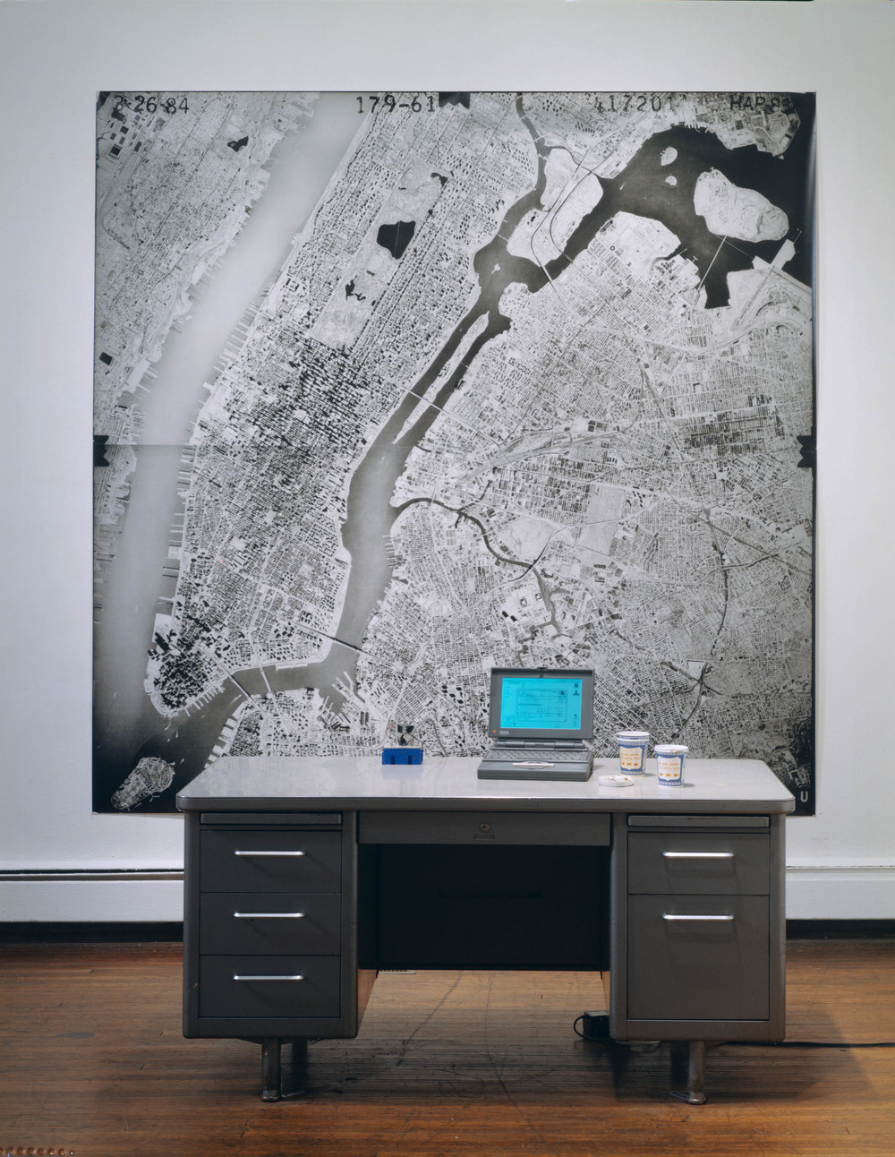 Where I'm At, 1993-1995, Black-and-white photograph, desk, computer with laser pointer, GPS unit, and cellular phone, 96 x 96 x 54 inches