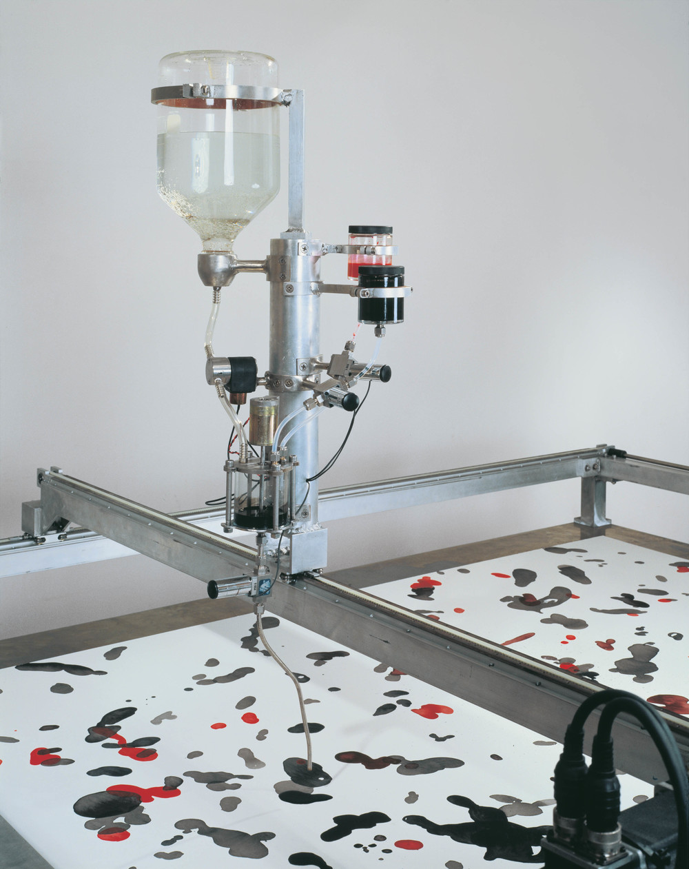 Drawing Machine, 2001, Aluminum, stainless steel, glass, valve, servo motors, track, computer, custom software, bearing, ink, and paper, 92 x 94 x 94 inches