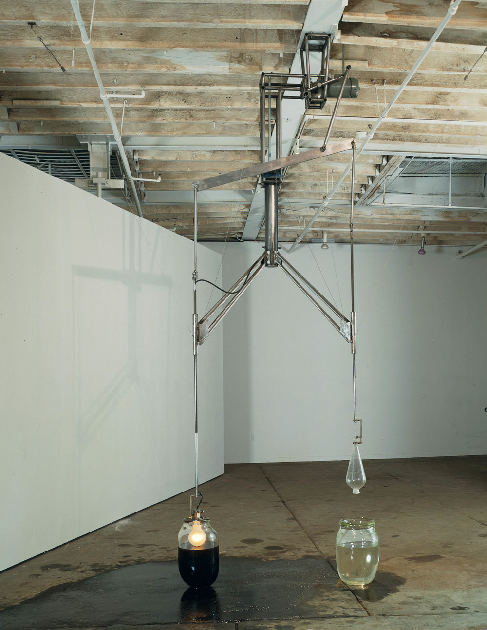 Lusts, 1992, Glass, water, lightbulb, steel, and motor oil, 100 x 20 inches