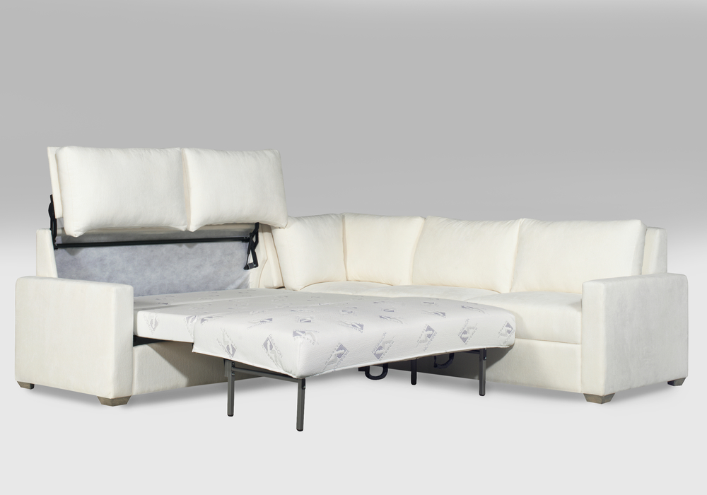 The Pelham Queen Sleeper With A Rounded Corner And Loveseat Sectional.