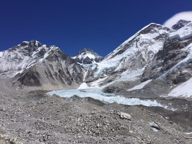 First view of base camp on the approach... the tiny colorful specs. Everest on far right with the lenticular cloud above.