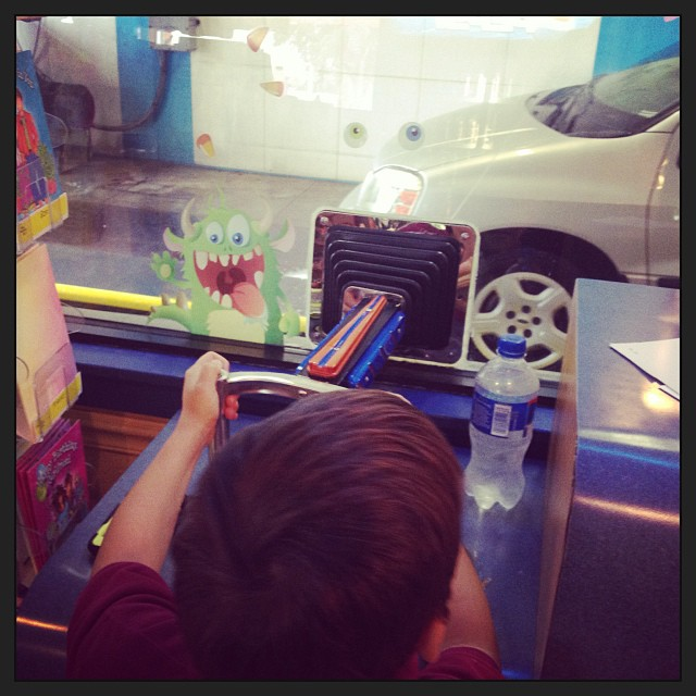 Me & my son are shooting guns @ cars today.. #rapdadswag (at Downtowner Car Wash)