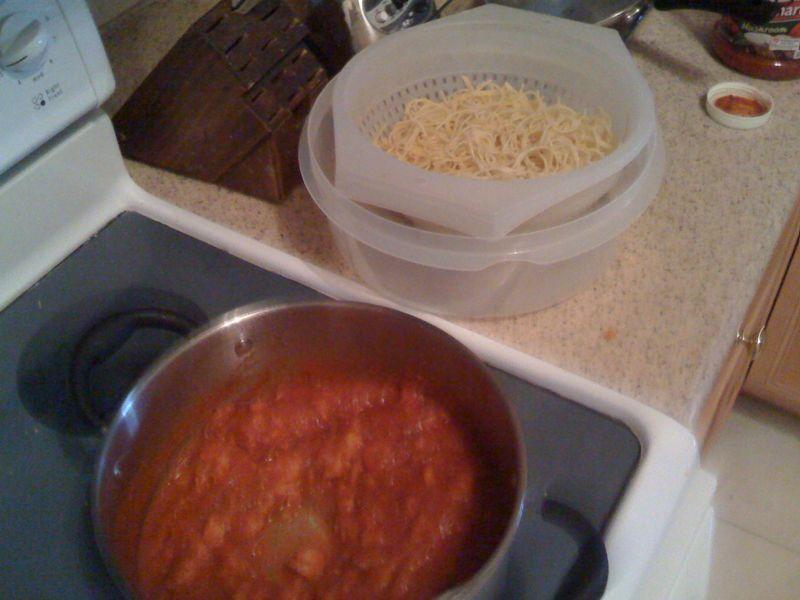 Spaghetti + salmon + shrimp + sauce = Tweezy is in the kitchen!