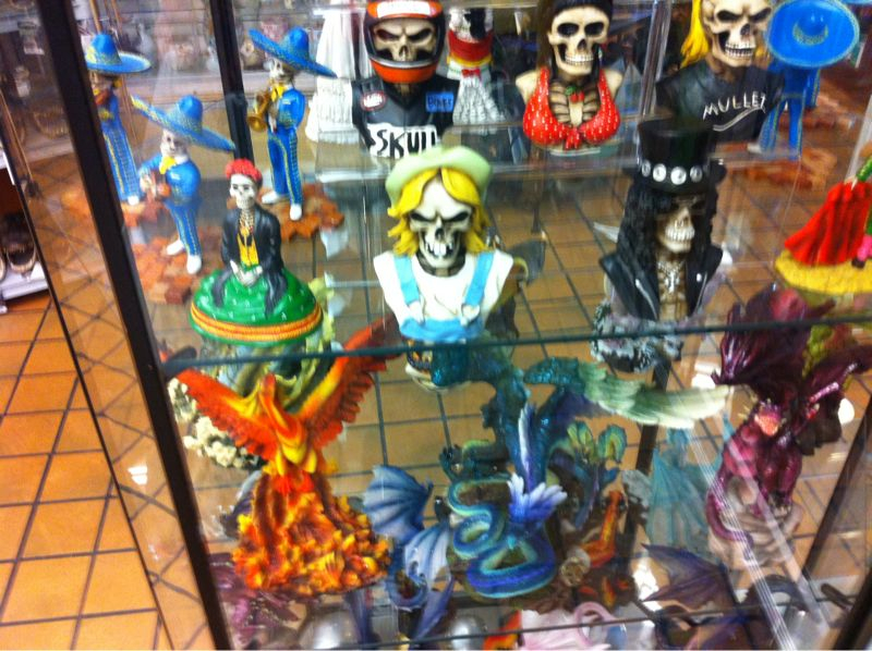 Epic truck stop merch #2: a skull w/ a mullet and a blue dragon?