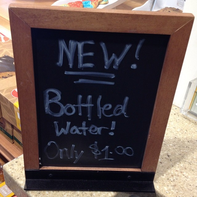 Have you heard? There's this new thing called bottled water out now! (Or maybe it means the new bottled water is a dollar and the old kind is .50)