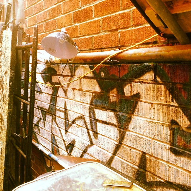 Found the remnants of not-so-great graff piece I did nearly 15 years ago still hanging in the alley way.. Always wanted to leave a mark on this world just didn't know it would be illegally.. J/k