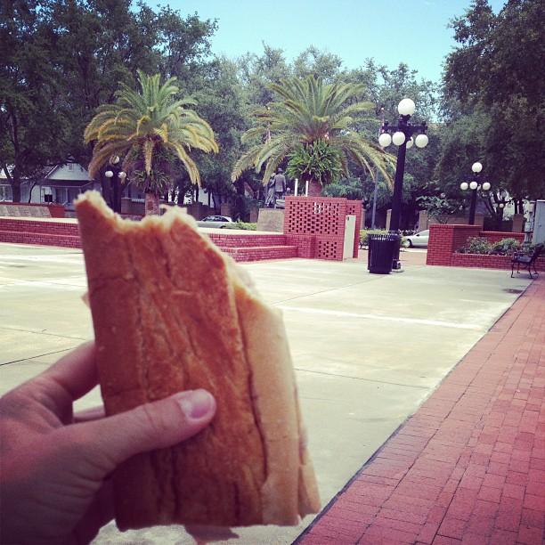 Eating a pressed Cuban sandwich in Ybor City w/ my fam in the spot I used to play @ as a kid.. Not much better than this. (at Centennial Park)