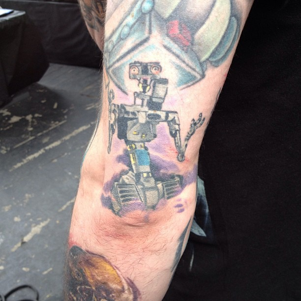 Johnny 5 is alive (& he lives on this guys arm) #needinput (at Six Flags Over Texas)