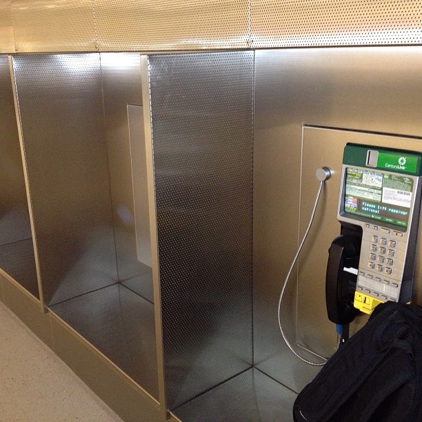 "Today is Natl. hug-a-pay phone day.. If you have a pay phone in ur neighborhood swing by & say ""hi"". They haven't had any love since the ""pagers"" era. (at Concourse C)"