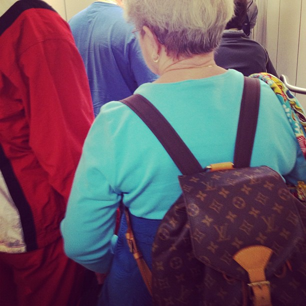 This lady & Kanye West both rock the same backpack.. Does that mean she likes rapper gear or he likes grandma gear? #louisvoittongrandmom