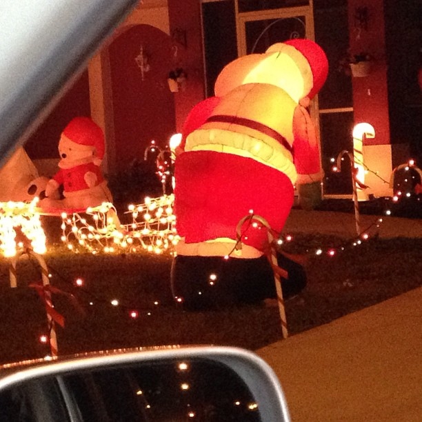 Not only is Santa getting his sag' on apparently he's mooning everyone who drives by.. Well played sir well played..