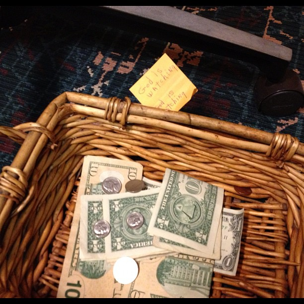offering basket in the airport chapel.. This is what was on a post it note taped to the basket. :)