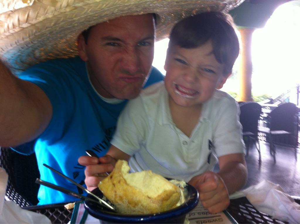 Thugged out w/ my lil' cub scout.. Eating bday dinner with a sombrero on (the restaurant made me wear it)