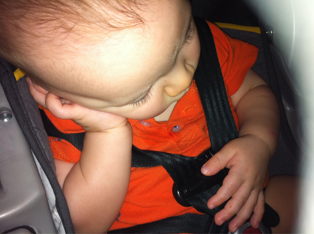 My kid fell asleep like this in the car seat.. Looks like he's either bored or contemplating how to solve world hunger.