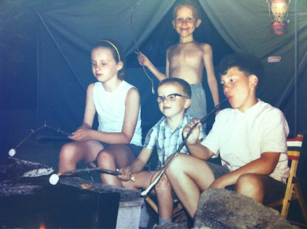 This kid in the back of this camping ad looks like he's gonna roast all his homies along w/ his s'mores..