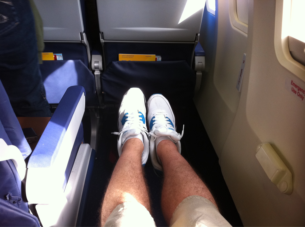 I have so much legroom on this flight I could build a condo.. or @ least do my insanity cardio abs workout. #wheeeeeeeeee!