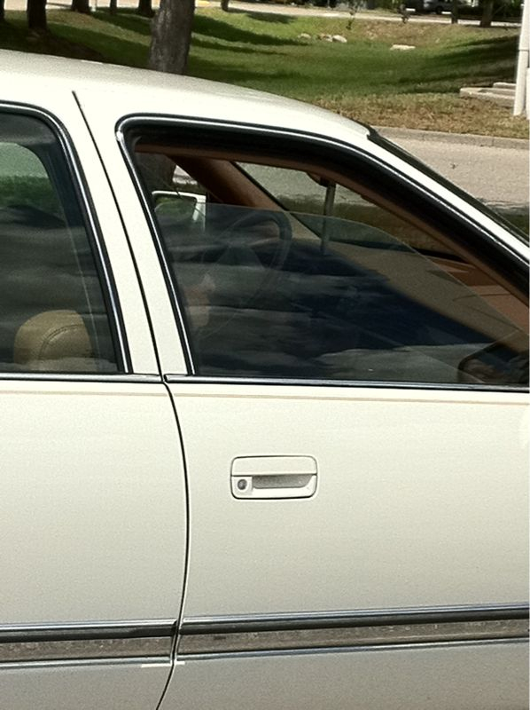 Wow..this guy left his g-ma in the Cadillac w/ the window cracked like it was his dog..