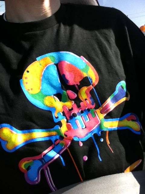 "So apparently my shirt is ""if a skittles bag threw up on a pirate flag.."""
